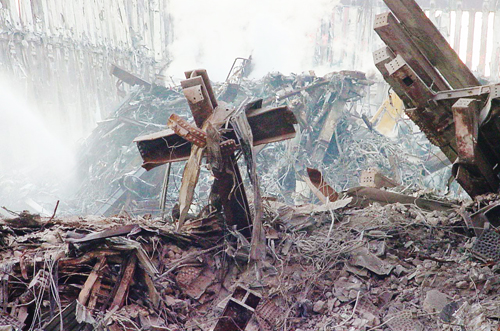 [Photo of a cross in the rubble of the World Trade Center]