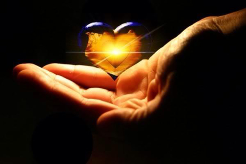 [Photo of an outstretched hand holding a glowing heart]
