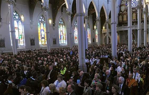 [Photo of people inside a church]