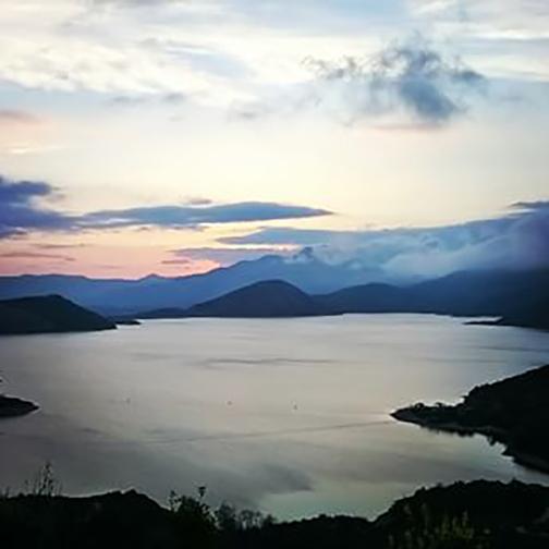 [Photo of a mountain lake at sunrise]