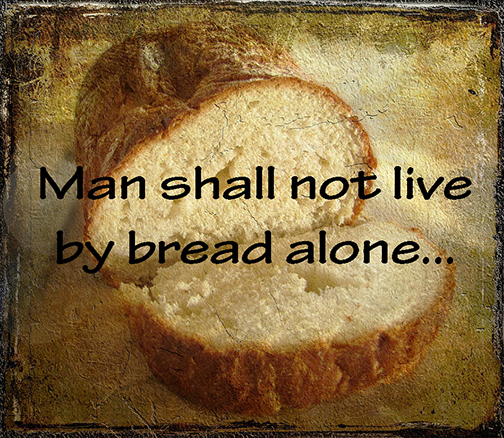 [Photo of a loaf of bread with words superimposed]