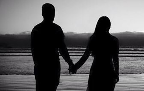 [Photo of a couple holding hands in silhouette]