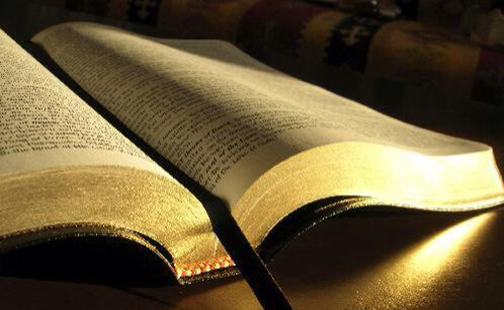 [Photo of an open Bible]