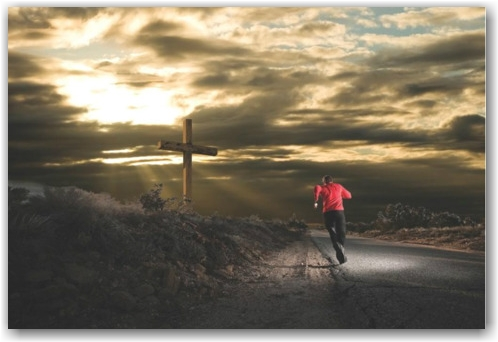 [Photo of a runner running toward a cross at daybreak]