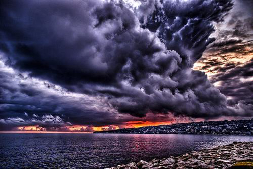 [Photo of storm clouds over water]