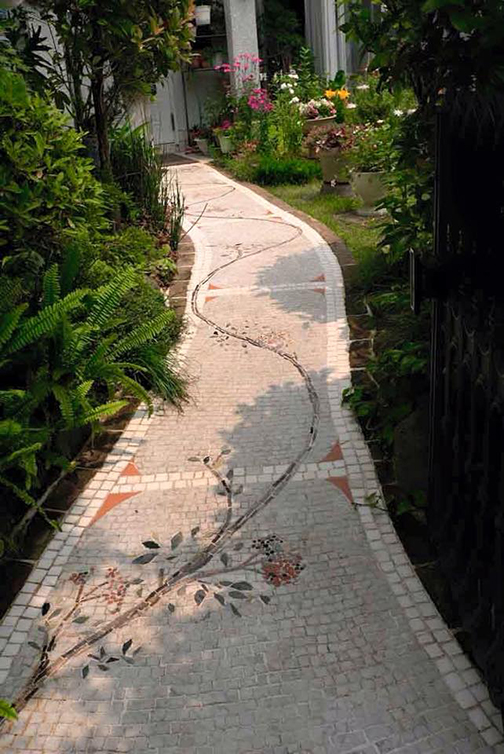 [Photo of a path with a vine superimposed]
