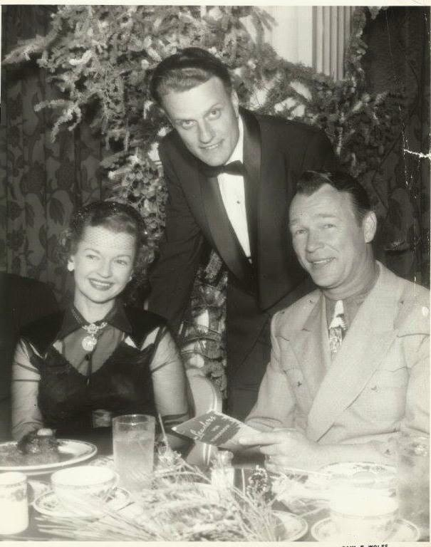 [Photo of Billy Graham with Roy Rogers and Dale Evans]